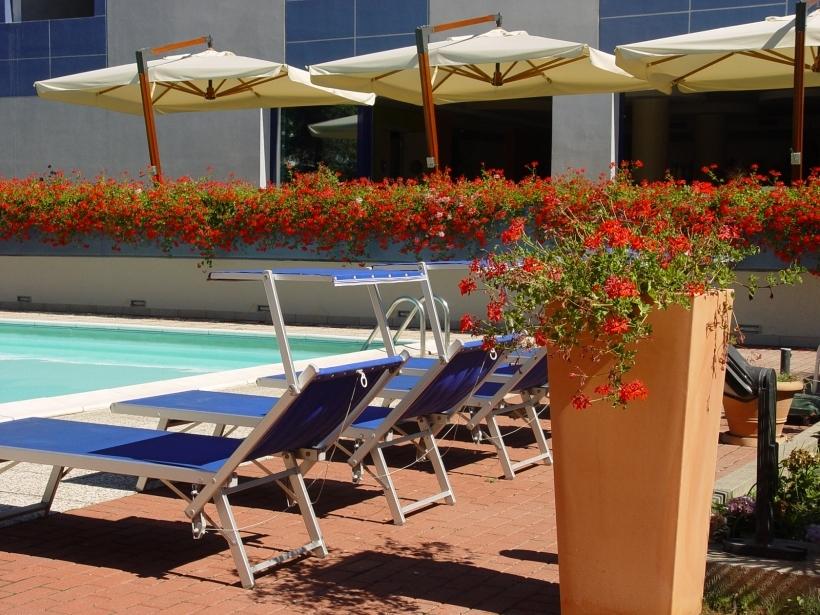 Sunbathe on a deckchair near the pool